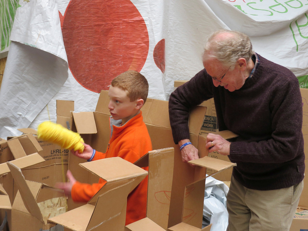 . Alexander Nadelberg of Lexington, Mass. works with his grandfather and architect Peter Shaffer of Tyringham and Boston to create crenellations for a cardboard castle at the Berkshire Museum\'s Ten Days of Play exhibit in Pittsfield. Jenn Smith/Berkshire Eagle Staff Monday, Feb. 17, 2014