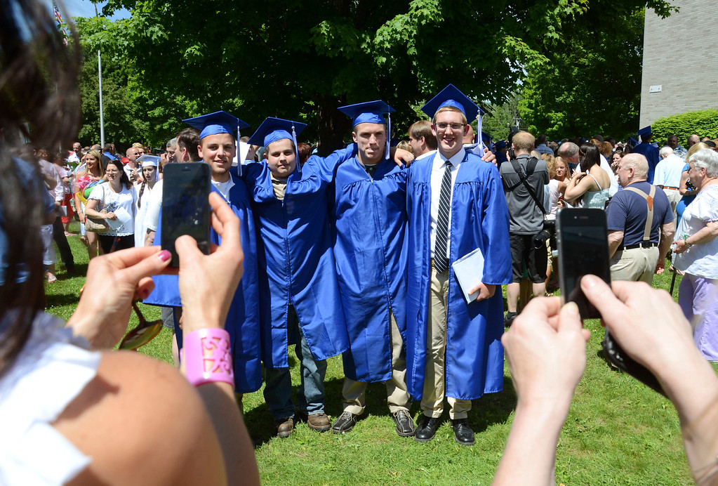 . Graduates pose for pictures outside Wahconah Regional High School following graduation.  June 8 2014 Caroline Bonnivier Snyder