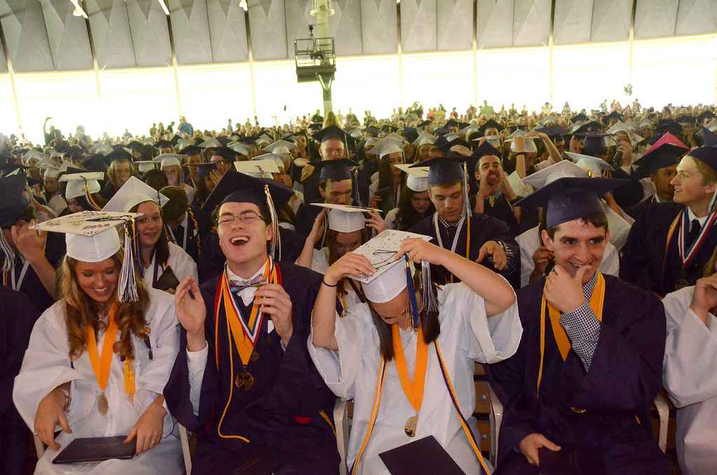 . Pittsfield High School student graduates celebrate at the end of graduation exercises at Tanglewood on Sunday, June, 8, 2014. Gillian Jones / Berkshire Eagle Staff / photos.berkshireeagle.com