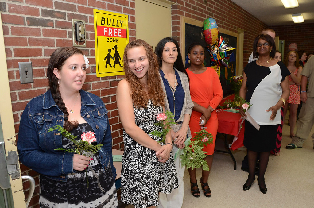 . Graduates of the Pittsfield Adult Learning Center get ready to march into their graduation and awards ceremony at Crosby Elementary School on Tuesday, June, 10, 2014. Gillian Jones / Berkshire Eagle Staff / photos.berkshireeagle.com