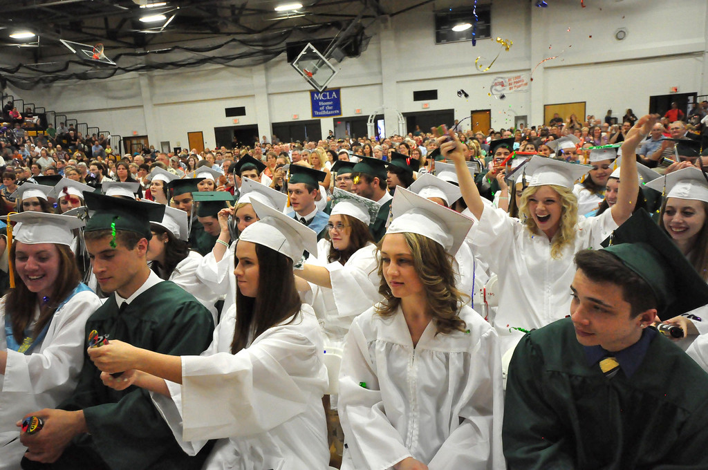 . Students celebrate with confetti during graduation exercises of McCann Technical School in the Amsler Campus Center at MCLA on Wednesday, June 4, 2014. Gillian Jones / Berkshire Eagle Staff / photos.berkshireeagle.com