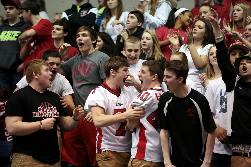 . In support of their female counterparts, many members of the Hoosac boys basketball team cheer for the girls as they win the state semifinal basketball game against Bellingham at the MassMutual Center in Springfield. Tuesday, March 11, 2014. Stephanie Zollshan / Berkshire Eagle Staff / photos.berkshireeeagle.com