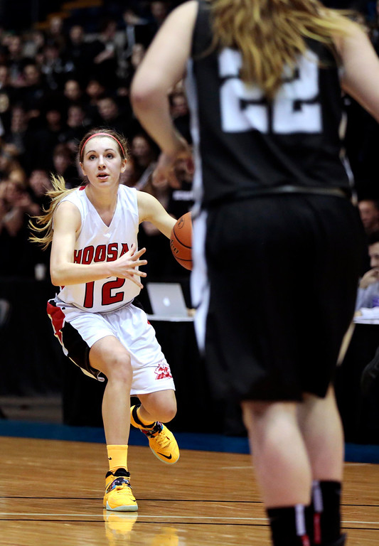 . Hoosac\'s Megan Rodowicz looks for a teammate in the state semifinal basketball game that they won against Bellingham at the MassMutual Center in Springfield. Tuesday, March 11, 2014. Stephanie Zollshan / Berkshire Eagle Staff / photos.berkshireeeagle.com