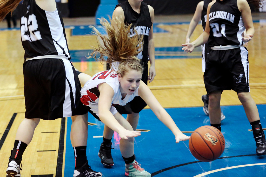 . Hoosac\'s Madison Ryan is tripped and takes a spill in the state semifinal basketball game that they won against Bellingham at the MassMutual Center in Springfield. Tuesday, March 11, 2014. Stephanie Zollshan / Berkshire Eagle Staff / photos.berkshireeeagle.com