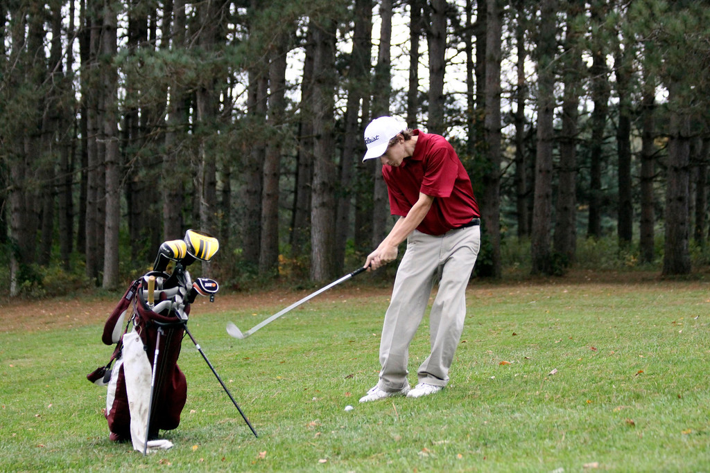 . Dillion Buffoni, a sophmore of Monument Mountain lines up a shot at the Pontoosuc Lake Country Club on Thursday, Oct. 10, 2013. (Holly Pelczynski/Berkshire Eagle)