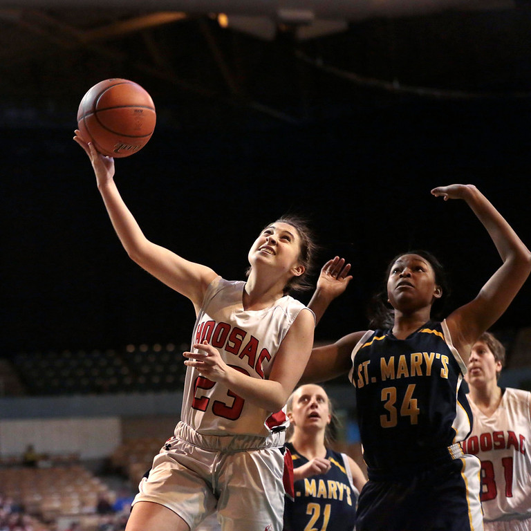 . Hoosac\'s Mckenzie Robinson takes a shot during the state basketball championship game against St. Mary\'s in Worcester. Saturday, March 15, 2014. Stephanie Zollshan / Berkshire Eagle Staff / photos.berkshireeagle.com