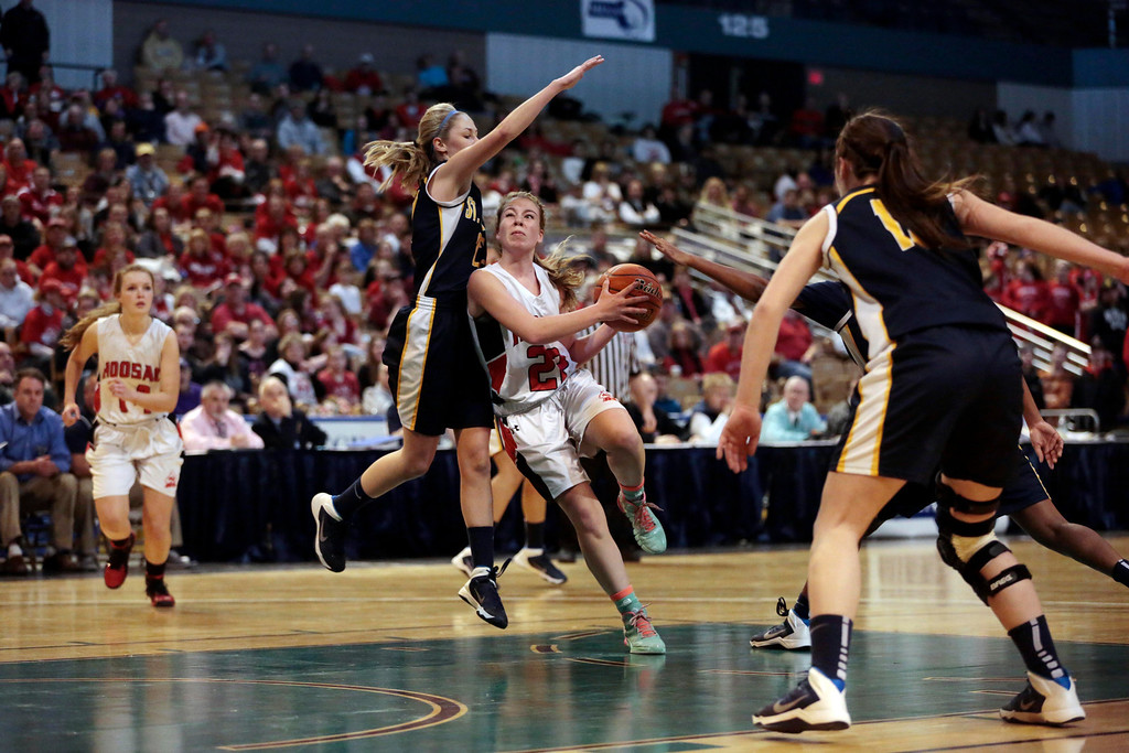 . Hoosac\'s Madison Ryan goes to the basket during the state basketball championship game against St. Mary\'s in Worcester. Saturday, March 15, 2014. Stephanie Zollshan / Berkshire Eagle Staff / photos.berkshireeagle.com