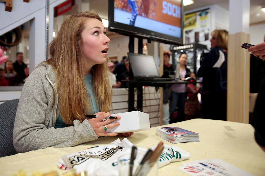. Sochi Olympic gold medalist Mikaela Shiffrin receives a box of cider donuts from the family at Bartlett\'s Orchards during her visit to Plaine\'s Bike, Ski and Snowboard to meet fans and sign autographs. Wednesday, April 9, 2014. Stephanie Zollshan / Berkshire Eagle Staff / photos.berkshireeagle.com