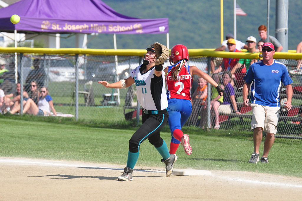 . Rochester\'s Madison Provencher makes the run as Berkshire Force\'s Emily Koldys is ready for the ball at first in the Commissioner\'s Cup. Gillian Jones / Berkshire Eagle Staff / photos.berkshireeagle.com
