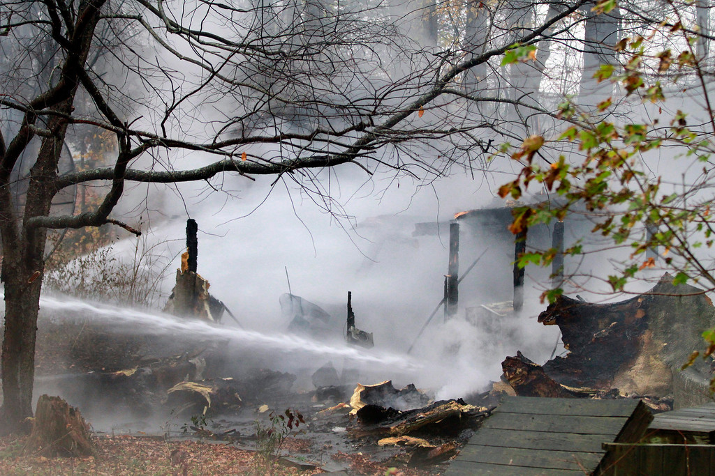 . Pittsfield, Cheshire, and Lanesborough fire departments fight a fire that leveled a house on National Street in Lanesborough. The house was insulated with foam, making the blaze burn fast. Thursday, October 31, 2013. (Stephanie Zollshan | Berkshire Eagle Staff)