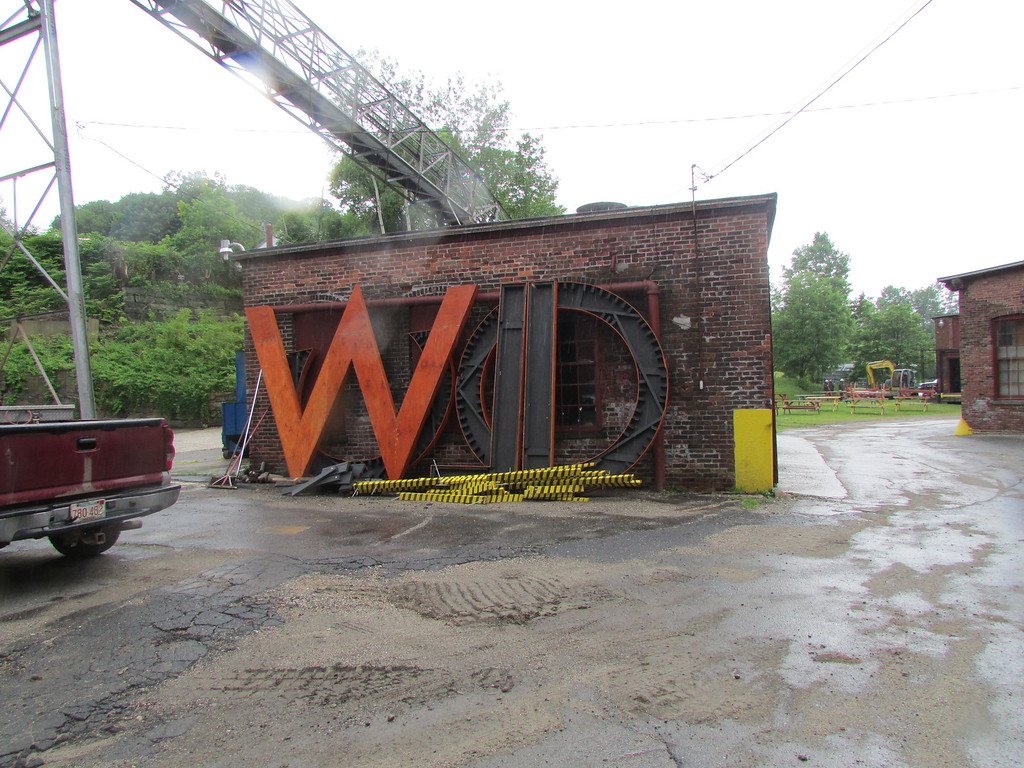 . Large letters that spell Wilco, which covered the Mass MoCA sign in 2010, wait to be hung for Solid Sound Festival 2013 on Tuesday.. (Jennifer Huberdeau/North Adams Transcript)