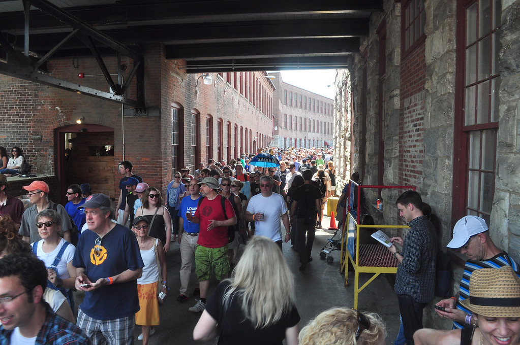 . Jack Guerino/ North Adams Transcript Concert goers filter into the courtyard in MASS MoCA to hear music at the Solid Sound Festival Saturday.