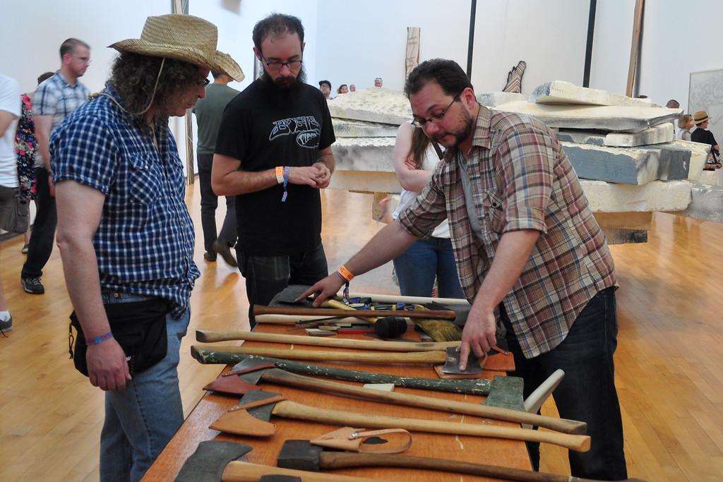 . Jack Guerino/ North Adams Transcript Nick Zdon gives an axe restoration and sharpening workshop at MASS MoCA Saturday at the Solid Sound Festival.