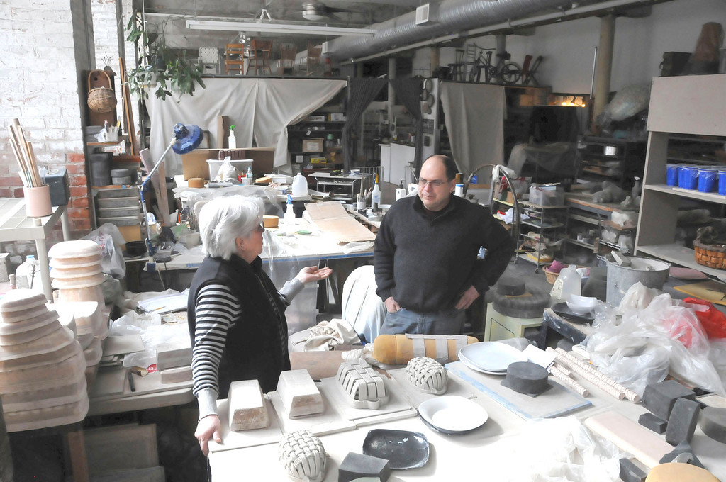 . Phil and Gail Sellers in their ceramics studio in the Eclipse Mill in North Adams. Their living space is attached to both their pottery studio and store, River Hill Pottery. Monday, March 3, 2014 (Scott Stafford/Berkshire Eagle Staff)