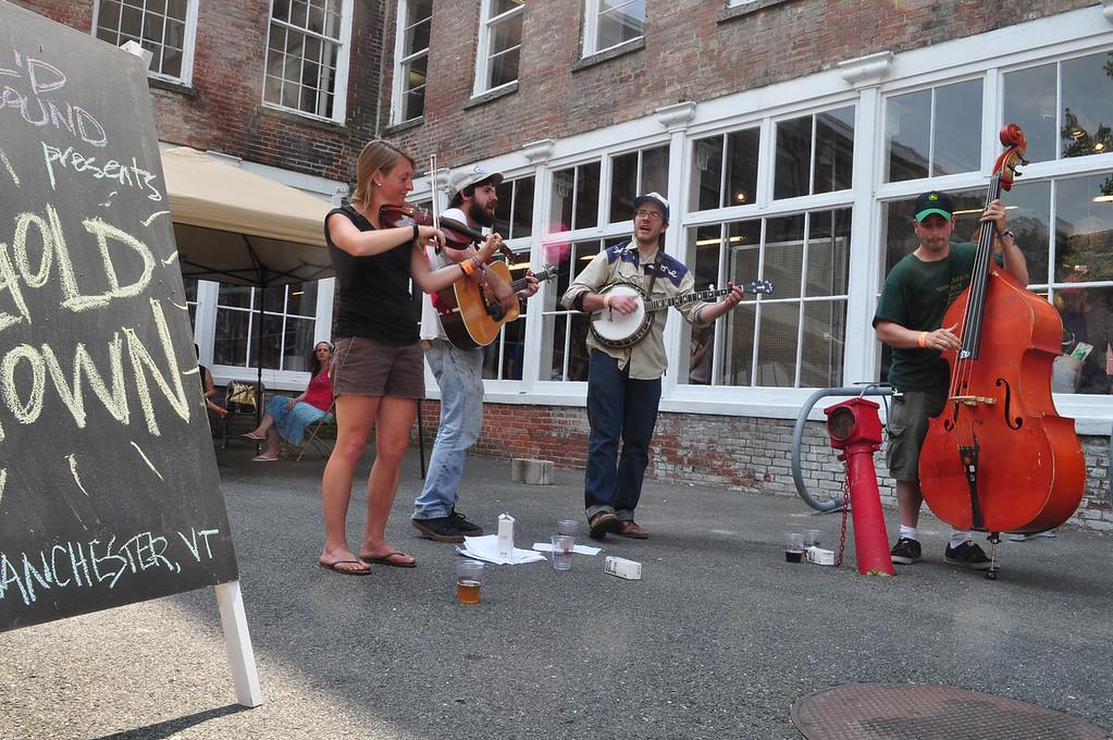 . Jack Guerino/ North Adams Transcript Gold Town plays bluegrass music outside of MASS MoCA.