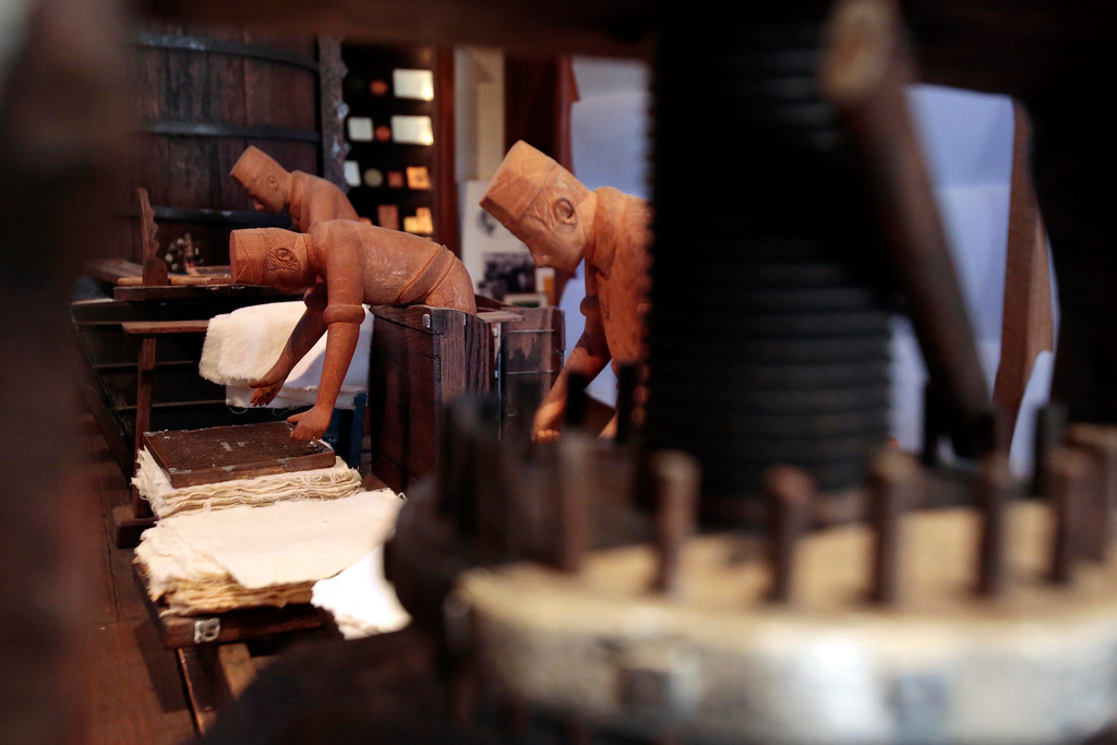 . Figures depicting the process of how paper was made in the late 1800s are on display at the Crane Museum of Papermaking in Dalton. Wednesday, Feb. 26, 2014. Photo by Stephanie Zollshan / Berkshire Eagle Staff.