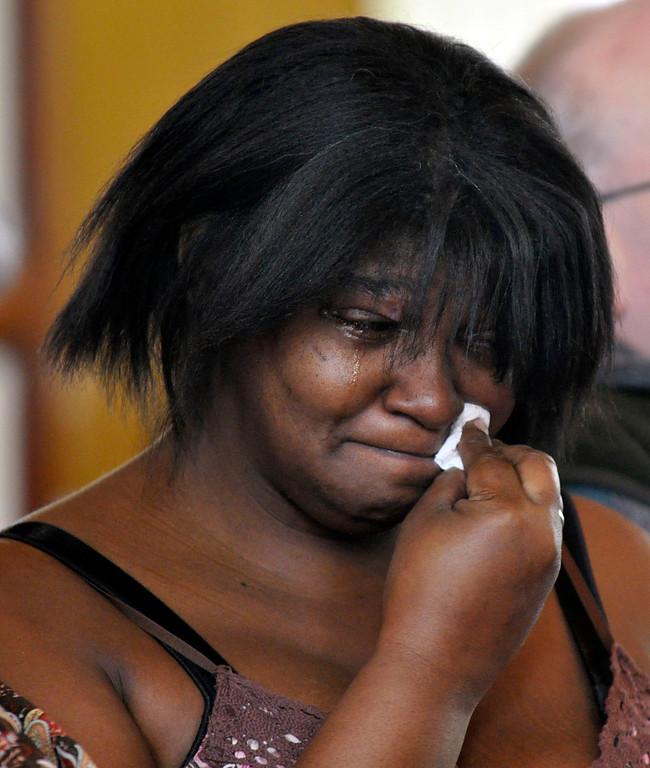 . Coralynn Butler weeps at a memorial service for David Glasser held at Price Memorial AME Zion Church in Pittsfield, Mon Nov 28, 2011 (GARVER)