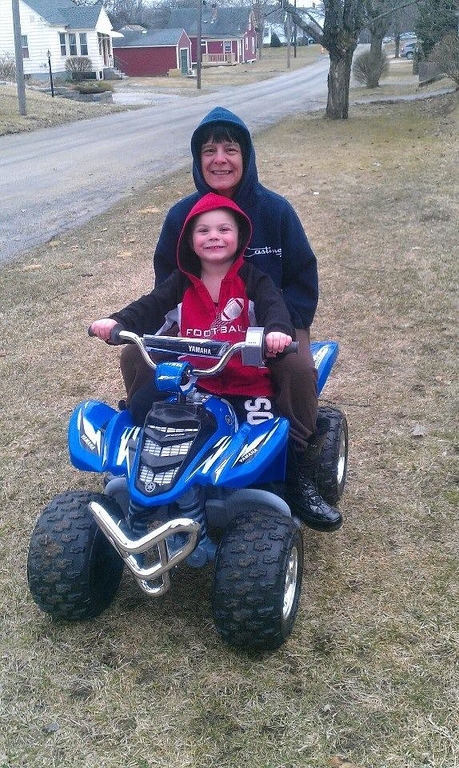 """. Tyler Ireland gives his grandmother Melissa Ireland a ride on his four-wheeler. Tyler\'s mom Becca Loria writes in an email, \""""She is a major part of Tyler\'s life and has always been there for any support or assistance.\"""" Photo submitted by Becca Loria"""