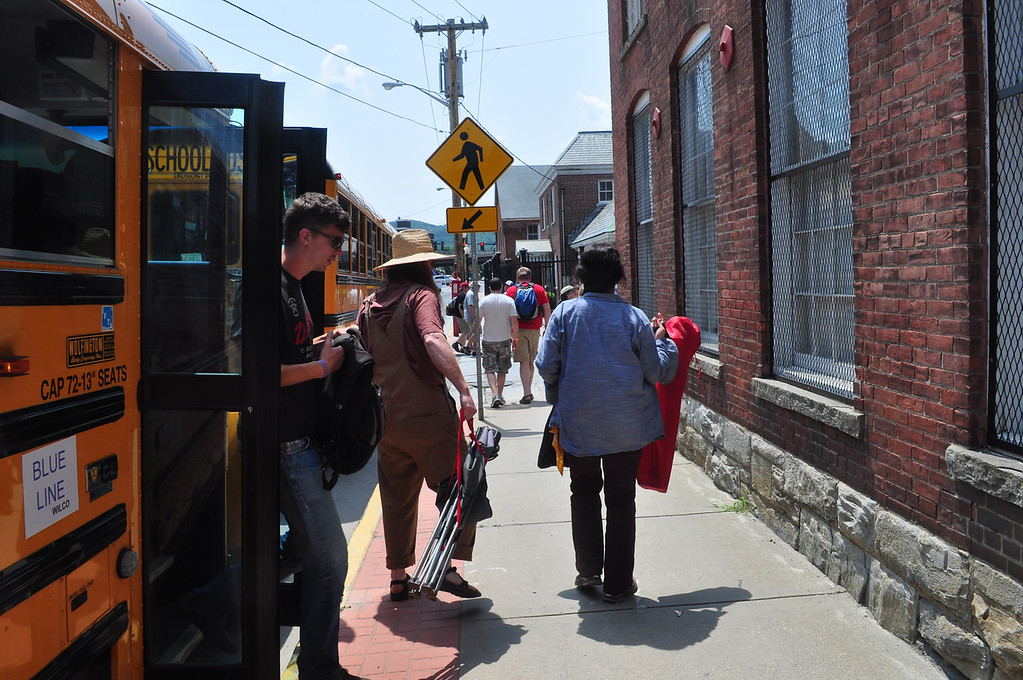 . Jack Guerino/ North Adams Transcript Concert goers get off of busses provided to shuttle people to MASS MoCA during the Solid Sound Festival Saturday.