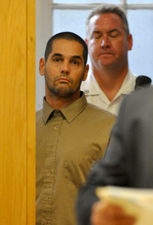 . David Chalue, 44, is arraigned in Berkshire District Court on charges of murder and kidnapping of three Pittsfield, Ma men.  CHalue was charged with Adam Lee Hall and Caius Veiovis after the bodies of David Glasser, Edward Frampton and Robert Chadwell were discovered over the weekend.  Pittsfield, Monday September 12, 2011 (Ap Photo by Ben Garver, The Berkshire Eagle)