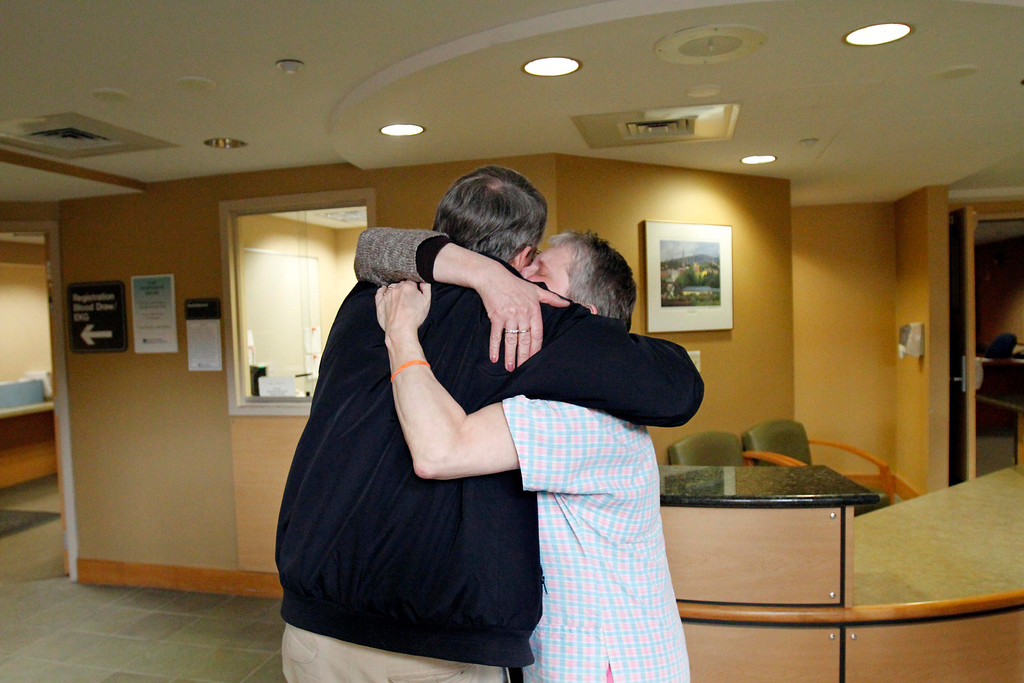 . Debbie Little, and retired internist Erwin Steubner, M.D. hug after the sudden announcement of the closure of the North Adams Regional Hospital on Tuesday, March 25, 2014. Stephanie Zollshan / Berkshire Eagle Staff / photos.berkshireeagle.com