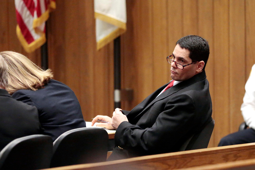 . Defendend David Chalue looks at the jury as Berkshire District Attorney David Capeless gives his opening remarks during the first day of Chalue\'s trial for triple homicide and kidnapping in 2011 at Springfield Superior Court. April 25, 2014. Stephanie Zollshan / Berkshire Eagle Staff